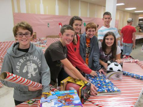 In 2013, the Folks Middle School National Junior Honor Society held its first annual wrapping party to help out local charity Elf Louise. Members met at the Elf Louise facility after school and stayed for two hours wrapping gifts for over 15 families.